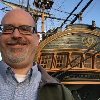 Nick Senger in front of HMS Surprise